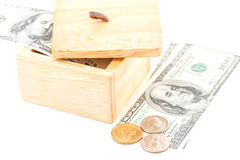 Saving by dollar and coin with wooden box Stock Images