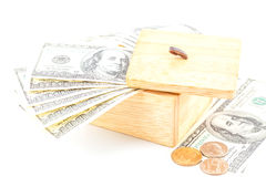 Saving by dollar and coin with wooden box Royalty Free Stock Photo
