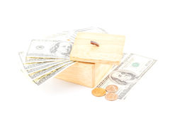Saving by dollar and coin with wooden box Stock Image