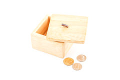 Saving by dollar coin with wooden box. Stock Photos