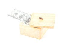 Saving by dollar with wooden box. Royalty Free Stock Photography