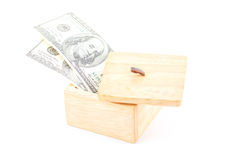 Saving by dollar with wooden box. Stock Photography