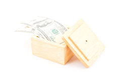 Saving by dollar with wooden box. Stock Photos
