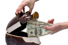 Saving of dollars. Man puts a money in money-box royalty free stock images