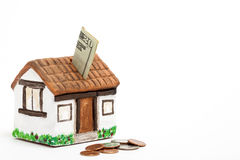 Saving dollars for a new house Royalty Free Stock Photography