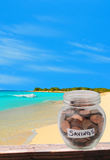 Saving for dream vacation. Saving pennies for retirement or saving for dream vacation concept Stock Image