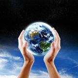Saving Earth concept Royalty Free Stock Photography