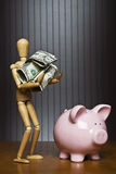 Saving is so easy even a dummy can do it. Royalty Free Stock Image