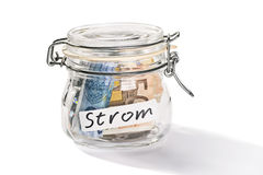 Saving for the electricity costs. Preserving jar with savings for the electricity costs Royalty Free Stock Images