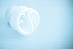 Saving Energy. Energy Efficient Light Bulb With Abstract Treatment stock photography