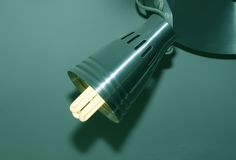 Saving energy light bulb. Switched on royalty free stock photography