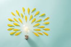 Saving energy with light bulb on the blue background.  royalty free stock image