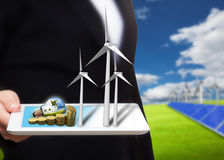 Saving energy stream images from tablet pc on the field with sol Royalty Free Stock Photography