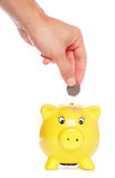 Saving fifty pence in a piggybank Stock Photos