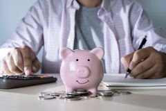 Saving for finance accounting Young is saving manage money inves. Tment royalty free stock photo