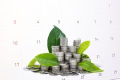 Saving frugal money in glass for your investment future. Saving frugal money in glass for your investment future is similar to growing green leaves on tree and stock photos