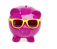 Saving for fun holiday vacation. Concept image of piggy bank wearing sunglasses Royalty Free Stock Photos