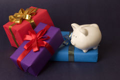 Saving for gifts. Gifts and piggy bank, concept for saving Royalty Free Stock Photos