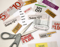 Saving on Groceries. Grocery list next to receipt with savings circled, scissors and  cut out ads promoting lower costs Stock Photography
