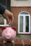 Saving for a house. Piggy bank Stock Photography