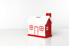 Saving for a house. Small model house box to save up all your money Stock Photo