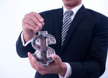 Saving, male hand putting a coin into financial symbol bank.  stock image