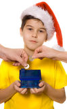 Saving money. Boy holding coin bank - isolated stock images