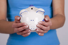 Saving money. Save money with your financial piggy bank royalty free stock image