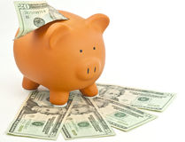 Saving money. A piggy bank representing the economy and saving money Royalty Free Stock Photo