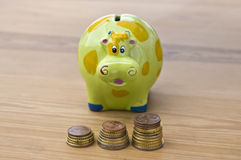 Saving money. Concept of saving money with some coins and good colors Royalty Free Stock Photography