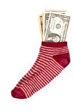 Saving money. Money in the red sock Stock Photos