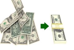 Saving Money. Pile of dollars shows savings of pack of 100 dollar bills Royalty Free Stock Photography