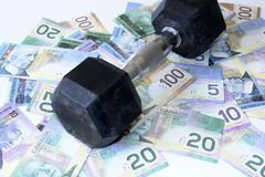 Saving Money. Weight holding money from bad spending habits Stock Photography