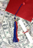 Saving money. A pile of fifty and hundred dollar bills. Saving for college Royalty Free Stock Photo