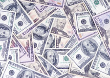 Saving money. A pile of fifty and hundred dollar bills. Saving for college Stock Images
