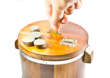 Saving Money. Put coin into wooden Saving Money stock image