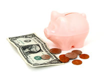 Saving Money. Money and piggy bank Stock Images