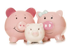 Saving money as a family piggy banks Royalty Free Stock Image