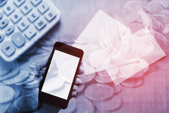 Saving money and banking for finance concept. Double exposure stack of coins with hand holding smart phone mobile and account banking for finace, Money and Stock Photo