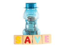 Saving money in blue dog as piggy bank Royalty Free Stock Photos