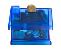Saving money in blue house bank Royalty Free Stock Photography