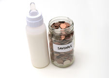 Saving money with breast milk or formula Royalty Free Stock Image