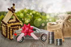 Saving money for car and home. The accumulation of money and Finance to real estate. Stock Images