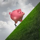Saving Money Challenge. As a person pushing up a piggy bank as a financial budgeting struggle metaphor with 3D illustration elements Royalty Free Stock Images