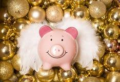 Saving money at christmas piggybank Royalty Free Stock Photo