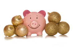Saving money at christmas piggybank Royalty Free Stock Photos