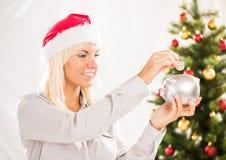 Saving money for christmas Royalty Free Stock Image
