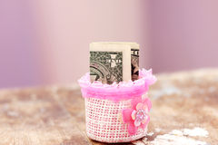 Saving money. In colorful box Stock Images