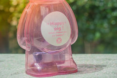 Saving Money Concept : Close up money on bottom of pink piggy bank. Royalty Free Stock Photography