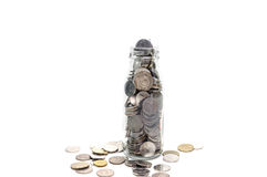 Saving money concept of collecting coins in glass bottle Isolate Stock Image